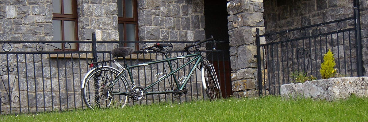 Tandem bicycle parked outside Clare's Rock hostel
